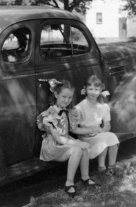 Denny and Pattie-Anne sitting on running board of Aunt Olive's car