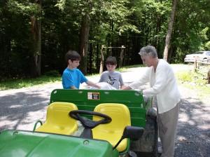 Ben, Aidan,  and Jeannie Whitehair preparing the Gator for the trip through the Fairy Forest.